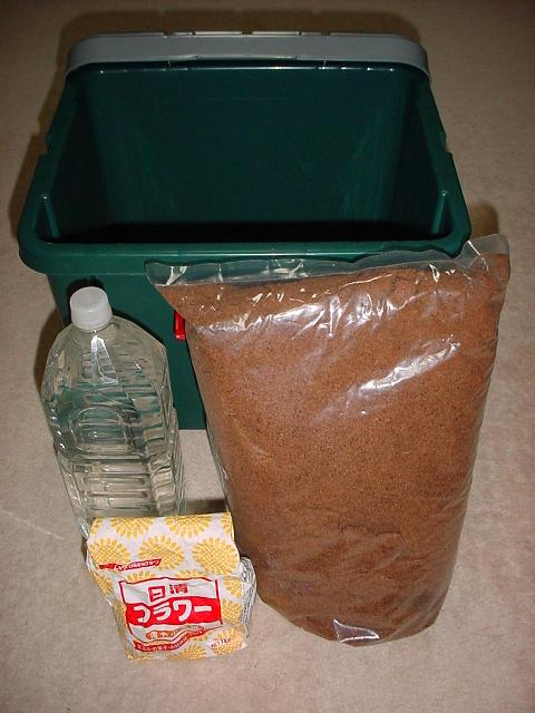 Figure 4  A container, a bottle of natural water, wheat flour and wood mulch