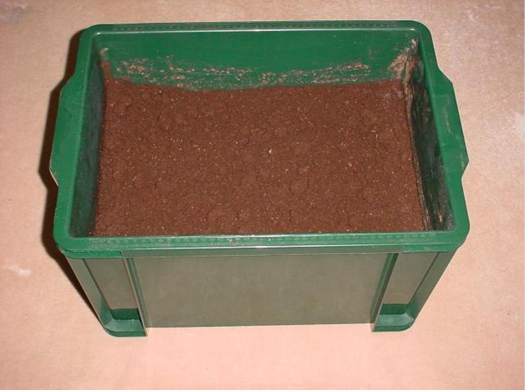 Figure 3.1.2  An example of a 60 liter container, filled with rearing substrate